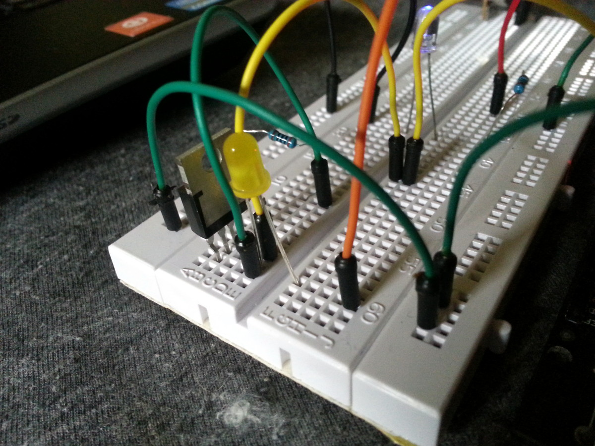 The yellow LED is powered through a MOSFET